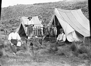 Rabbiters at campsite with their success